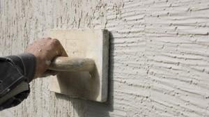 Plasterer flattening plaster